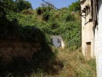 14.08.2010.- Imatge de la porta del túnel que comunica amb la font.